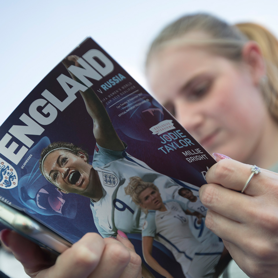 Woman reading England programme