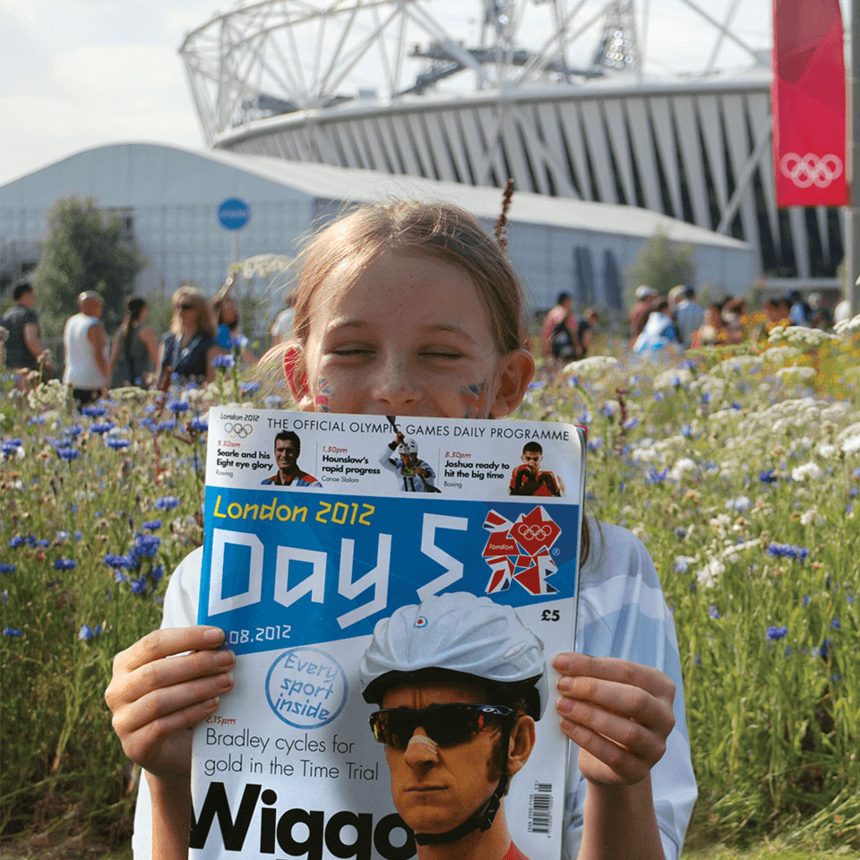 Young girl holding a London 2012 Olympic programme